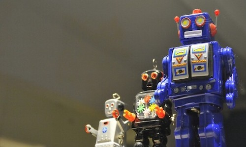 A trio of old toy robots.